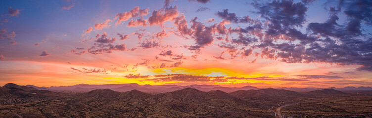 Poster Salmon Sunrise panorama over the sonoran desert of Arizona with layers of mountains shot at altitude by a drone.
