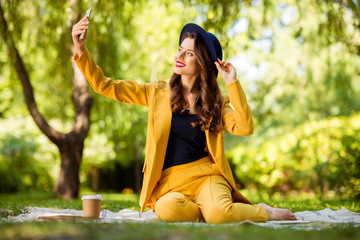 Fototapete - Portrait of her she nice-looking attractive lovely charming gorgeous pretty trendy cheerful cheery wavy-haired girl sitting on cover taking making selfie on fresh air outdoors
