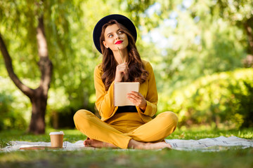 Aufkleber - Portrait of her she nice-looking attractive lovely charming gorgeous pretty dreamy trendy wavy-haired girl sitting on cover veil in lotus position creating notes on fresh air outdoors