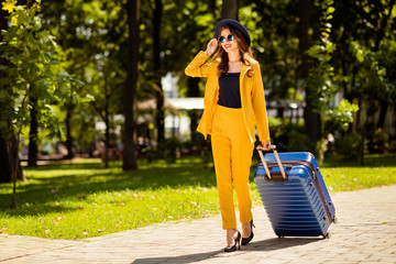 Aufkleber - Full length body size view of nice-looking attractive lovely trendy pretty cheerful wavy-haired girl on high heels going to airport railway station departure destination abroad in green park outdoors