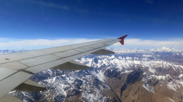 Snow mountain view  seen from airplane's window , airlines, Himalaya, travel concept, sky background