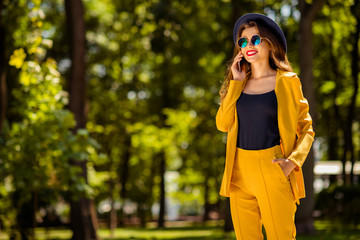 Fototapete - Portrait of her she nice-looking gorgeous attractive lovely charming pretty cute cheerful cheery fashionable girl spending free time springtime talking on phone outdoors