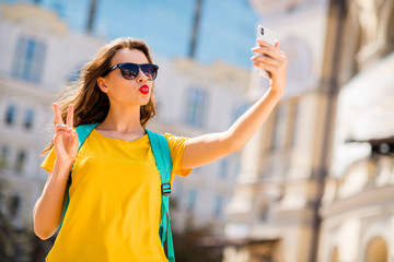 Fototapete - Portrait of her she nice attractive lovely winsome pretty glamorous cheerful cheery positive girlfriend taking making selfie showing v-sign sending air kiss outdoors