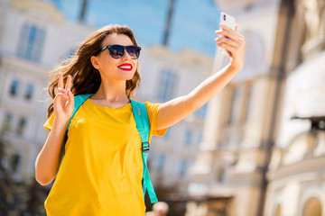 Fototapete - Portrait of her she nice attractive lovely pretty glamorous cheerful cheery positive girl wearing colorful yellow bright t-shirt taking selfie showing v-sign outdoors