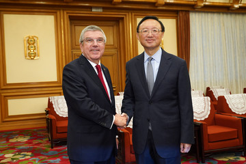 Chinese State Councilor Yang Jiechi shakes hands with President of the International Olympic Committee Thomas Bach at Zhongnanhai in Beijing