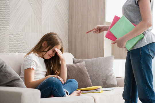 Mother scolds school crying daughter for homework