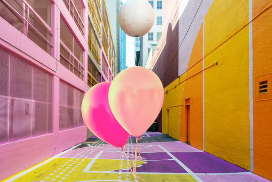 Pink balloons in Alley Oop, a colorful alley in Vancouver BC, Canada