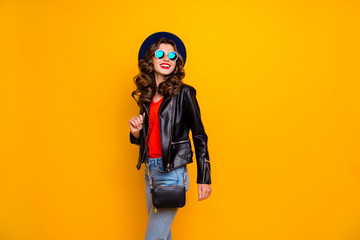 Fototapete - Photo of attractive lady walking down paris streets ready for shopping time wear stylish outfit with shoulder clutch isolated yellow background