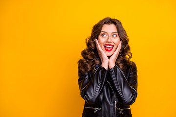Photo of overjoyed lady watching banner with low prices shopping wear leather jacket isolated yellow background