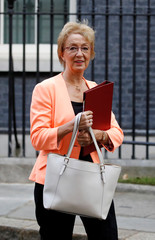 Britain's Secretary of State for Business Leadsom walks outside 10 Downing Street in London
