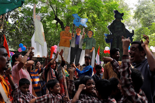 School children and supporters of India's ruling BJP cheer during an event to mark PM Modi's birthday at a school, in New Delhi
