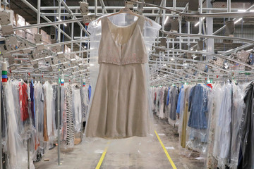 "A garment hangs in the automated sortation section at Rent the Runway's ""Dream Fulfillment Center"" in Secaucus, New Jersey"