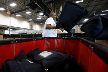 A worker arranges outbound products at the Rent the Runway Dream Fulfillment Center in Secaucus, New Jersey