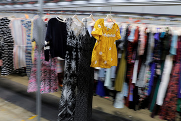 "Garments travel toward the steam tunnel at Rent the Runway's ""Dream Fulfillment Center"" in Secaucus, New Jersey"