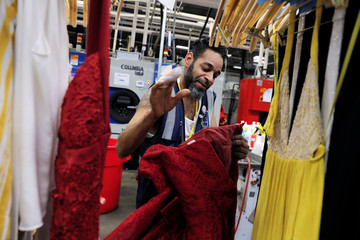 "A spotter prepares to clean clothing at Rent the Runway's ""Dream Fulfillment Center"" in Secaucus, New Jersey"