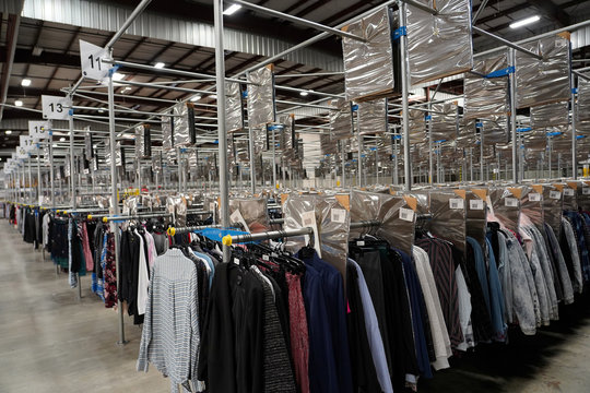 Clothes hang at subscription clothing rental company Le Tote's warehouse in Stockton