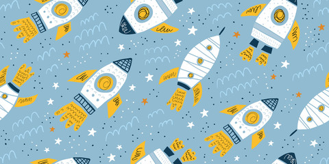Childish seamless pattern with hand drawn rockets