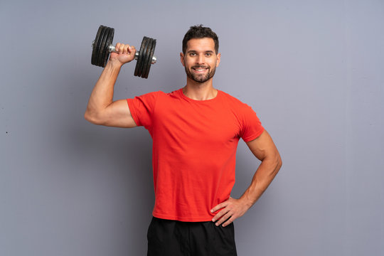 Young sport man making weightlifting