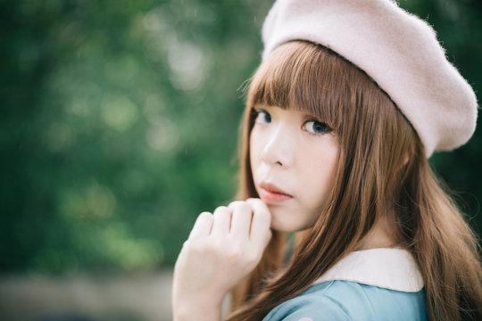 Portrait of asian girl in lolita fashion dress in garden background