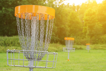 Disc golf basket in the park.