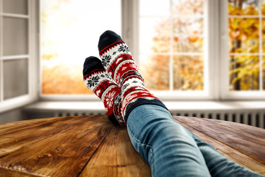 Autumn socks and open fall window background. Free space for your decoration.