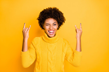 Lets rock together concept. Photo of naughty delightful ecstatic beautiful showing tongue girl making hard rock gesture with hands wearing knitted casual jumper isolated bright color background