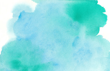 Blue green watercolor paint splash or blotch background with fringe bleed wash and bloom design, blobs of paint on watercolor paper texture grain