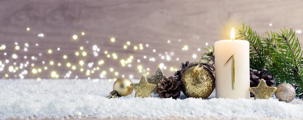 Fototapeta First Advent. Christmas background with Advent candle and golden decoration. obraz