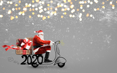 Santa Claus on scooter delivering Christmas or New Year 2020 gifts at snowy gray background Wall mural