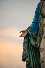 Focus on the hand of the blessed virgin mary,mother of Jesus on the blue sky, in front of the Roman Catholic Diocese, public place in Chanthaburi, Thailand.