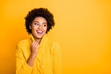 Photo of amazing dark skin lady listening funny joke wear warm knitted pullover isolated yellow background