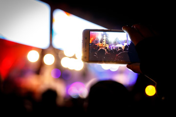 Supporters recording at concert - candid image of crowd at rock show