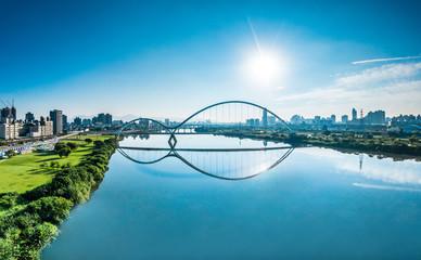Crescent Bridge - landmark of New Taipei, Taiwan with beautiful illumination at day, aerial photography in New Taipei, Taiwan.