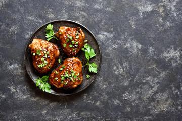 Foto op Canvas Gebakken Eieren Sweet and spicy honey grilled chicken thighs
