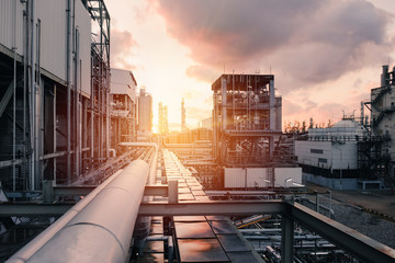 Pipeline and pipe rack of industrial plant with sunset sky background, Manufacturing of petrochemical industrial plant