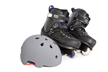 Close up of aggressive inline skates and a helmet