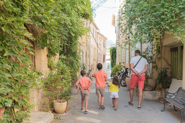 Beautiful streets of the village of Cucuron, in the Luberon, France. All its doors and windows are painted with pastel colors.