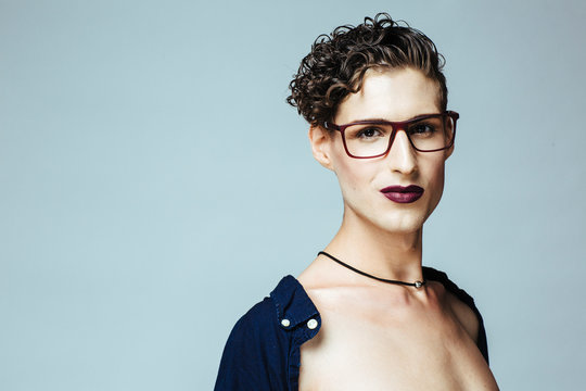 Portrait of a young  gender fluid person with make up