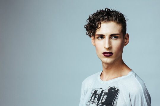 Portrait of a young  man with make up