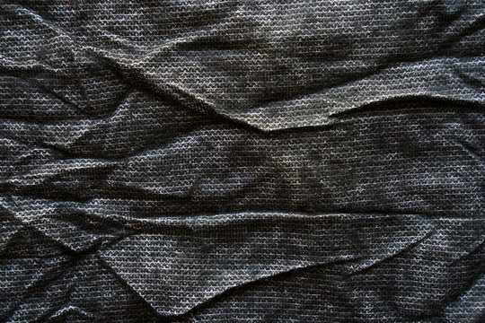 Crumpled black fabric texture. Clothing materials background