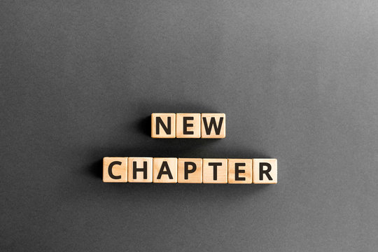 new chapter - words from wooden blocks with letters, starting new life new chapter concept,  grey background