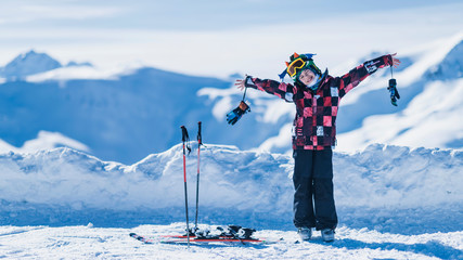Child on Top of the Mountain, Smiling, Enjoying Winter