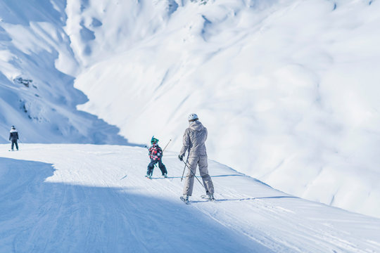 Mother and Son Skiing Together