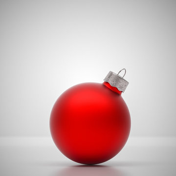 Matte red Christmas ball on light grey