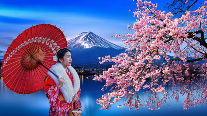 Wall Mural - Asian woman wearing japanese traditional kimono at Fuji mountain and cherry blossom, Kawaguchiko lake in Japan.