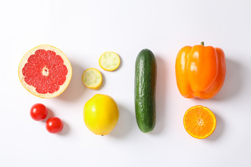 Flat lay with vegetables and fruits on white background, space for text