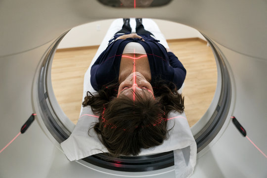 Clinic: Laser Guide Projected Onto Woman's Head For Scan