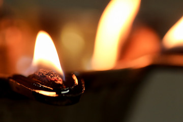 close up macro image of an oil lamp fire flame