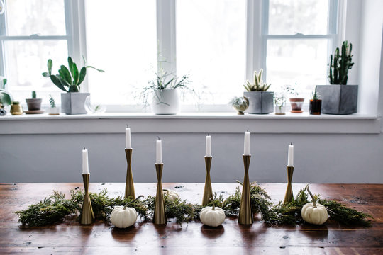 Candlesticks on Table and Assorted Cacti on Windowsill in Dining Room