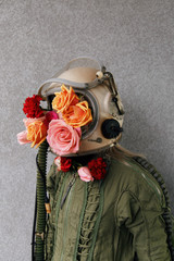 Woman in protection suit with delicate flowers